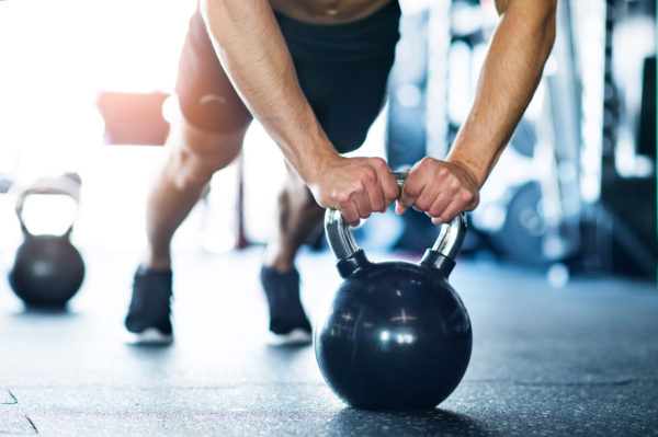 push ups on kettlebells